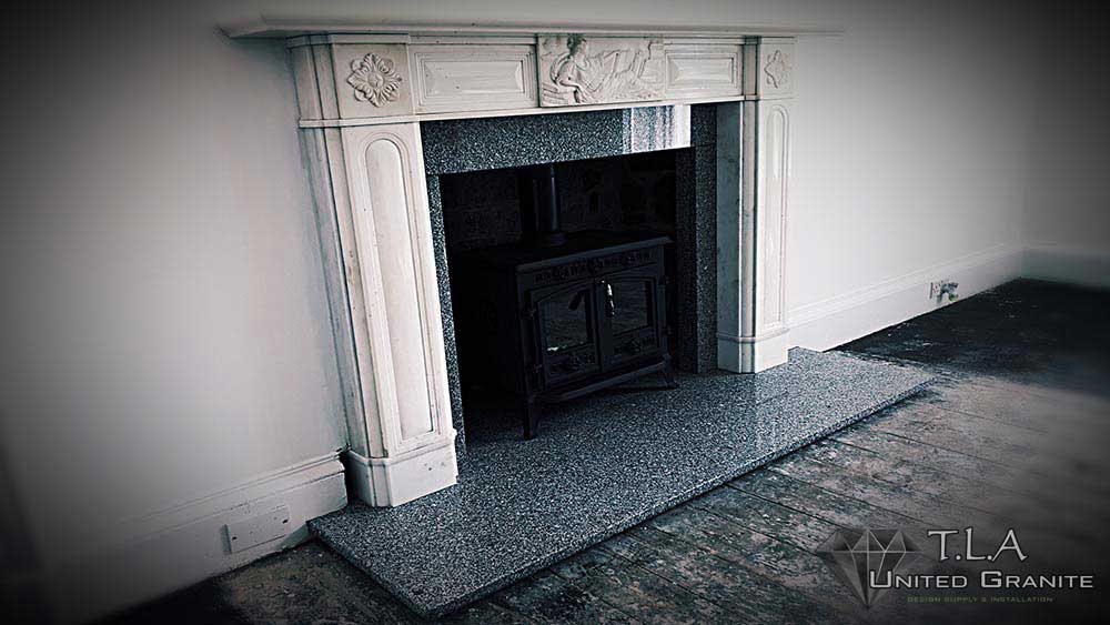 Black and white granite fireplace