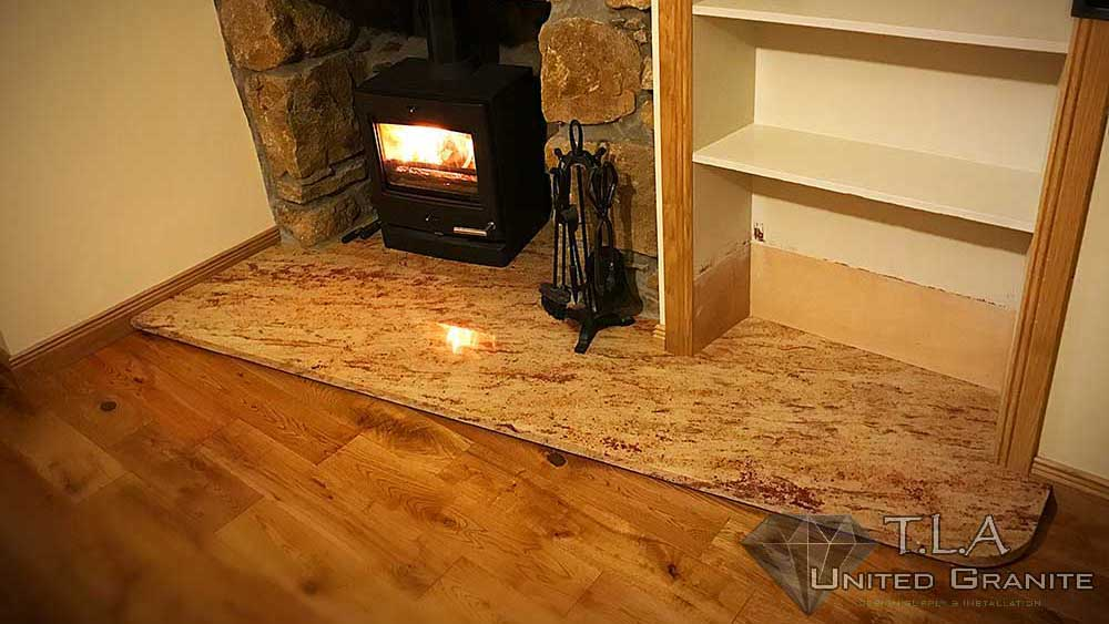 Brown and white granite fireplace